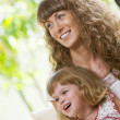 Portrait of beautiful young woman with her daughter — Foto de Stock