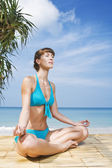 Portrait of young woman practicing yoga in summer environment — Stock Photo