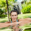 Portrait of young beautiful woman having good time in summer environment — Stock Photo
