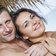 A portrait of attractive couple having fun on the beach — Stock Photo