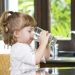 Portrait of little girl having drink in domestic environment — Stock Photo #26265663