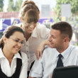 Stockfoto: Portrait of young business discussing project in office environment