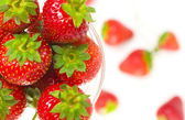 Close up view of fruit dish filled with nice red strawberries — Stock Photo