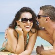 A portrait of attractive couple having fun on the beach. — Stock Photo
