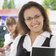 Portrait of young pretty woman in business environment — Stock Photo #26276523