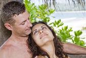 Portrait of attractive couple having fun on the beach. — Stock Photo