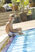 Portrait of little white boy having fun in swimming pool — Stockfoto