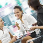 Portrait of young pretty women having coffee break in office environment — Stock Photo #26281355