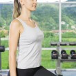 Stock Photo: Portrait of young woman getting busy in gym