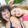 Portrait of two young attractive girls having good time — Stock Photo