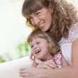 Portrait of beautiful young woman with her daughter — Stock Photo