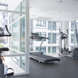 Panoramic view of modern style gym interior — Stock Photo