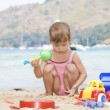 Portrait of nice little girl having fun on the beach — Stock Photo