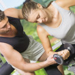 Portrait of young nice couple getting busy in gym — Stok fotoğraf