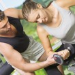 Portrait of young nice couple getting busy in gym — Foto Stock