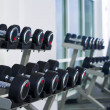 Stock Photo: Fragment like view of gym interior with some dumbbells
