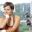 Portrait of young nice woman getting busy in gym — Stock Photo #28756295