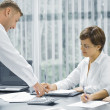 Portrait of young business discussing project in office environment — Stock Photo #28756461