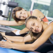 Portrait of young nice getting busy in gym — Stock Photo