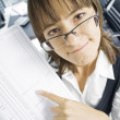Stock Photo: Portrait of young pretty woman in business environment