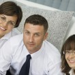 Portrait of young business discussing project in office environment — Stock Photo #28757293