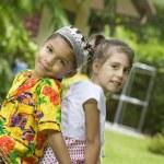Portrait of little kids having good time in summer environment — Stock Photo #28757317