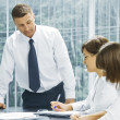 Portrait of young business discussing project in office environment — Stock Photo
