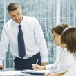Portrait of young business discussing project in office environment — Stock Photo #28758193
