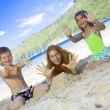 Portrait of little kids with mama having good time in summer environment — Stock Photo #28758253