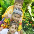 Portrait of little kids having good time in summer environment — Stock Photo #28758493
