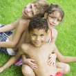 Portrait of little kids having good time in summer environment — Stock Photo #28758599