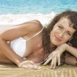 Stock Photo: View on young nice woman having good time on the tropic beach