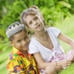 Portrait of little kids having good time in summer environment — Stock Photo