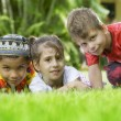 Portrait of little kids having good time in summer environment — Stock Photo