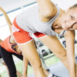 Stockfoto: Portrait of young nice getting busy in gym