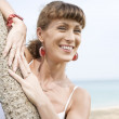 View on young nice woman having good time on the tropic beach — Stock Photo