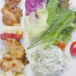 Close up view of nice delicious shish kebab on white back — Zdjęcie stockowe