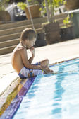 Portrait of little white boy having fun in swimming pool — Stock Photo