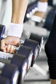 Fragment like photo of getting busy in the gym — Stock Photo