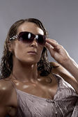 Stylish high-contrast portrait of nice woman in sunglasses — Stock Photo