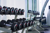 Fragment like view of gym interior with some dumbbells — Foto de Stock
