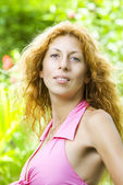 Portrait of nice woman in summer environment — Stock Photo