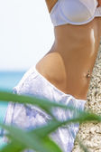 Close up view of well shaped womans belly in summer environment — Stock Photo
