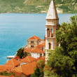 Venetian style church and tower in Mediterranean town — Stock Photo