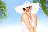Portrait of young beautiful woman in hat and sunglasses — Stock Photo