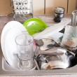 Dishes in the sink — Stock Photo