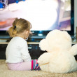 Baby watching television - Stock Photo