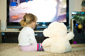 Baby watching television — Stock Photo