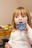 Little girl drinks water — Stock Photo