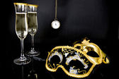 Champagne, Venetian masks and watch — Stock Photo